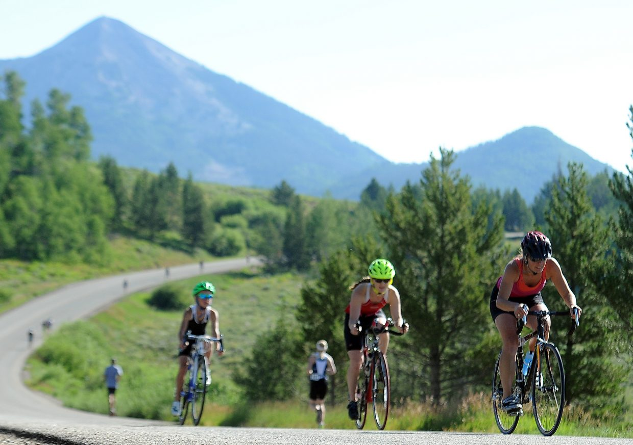 Andrea Abrahamson, of Oak Creek, leads a pack of cyclists Sunday during the third annual Steamboat Lake Sprint Triathlon. The event drew 320 finishers to North Routt County.