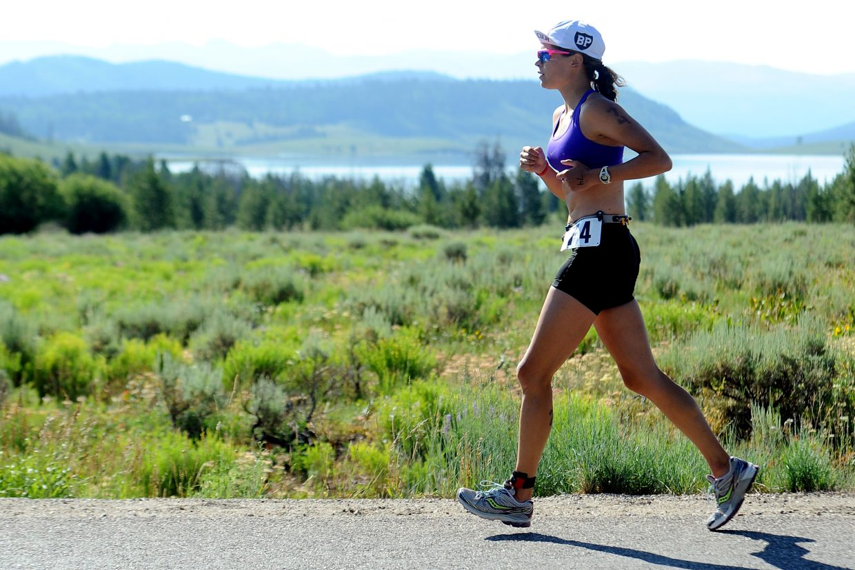 Lauren Danielsen runs next to Steamboat Lake on Sunday during the Steamboat Lake Sprint Triathlon.