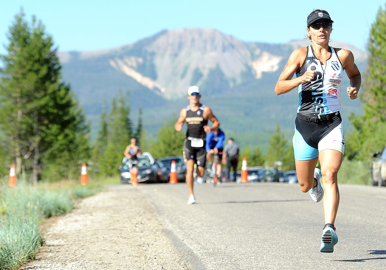Steamboat Springs triathlete Heather Gollnick runs in front of Sand Mountain on Sunday at the Steamboat Lake Sprint Triathlon. She won the women's division.