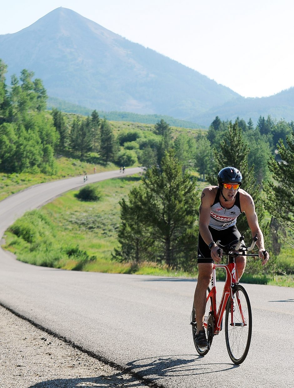 Ian Mallams rides Sunday in the Steamboat Lake Sprint Triathlon. He won the race.