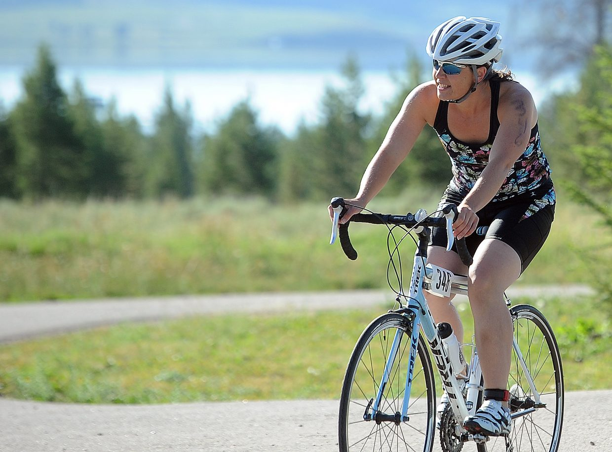 Rebecca Watson rides Sunday in the Steamboat Lake Sprint Triathlon.
