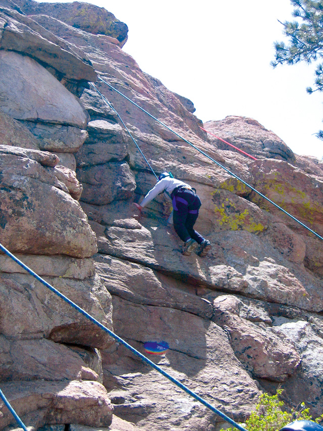 A woman exercises trust and courage during the Women's Survivor Course at Outward Bound in Leadville two years ago.