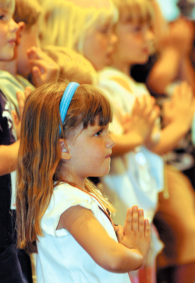 Five-year-old Katelyn Olinger performs during the final day of Vacation Bible School at Concordia Lutheran Church on Friday afternoon. The school ran all week, and the children ended the classes with a short presentation before releasing balloons.