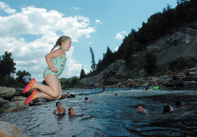 Brooke Green jumps into the cool waters of the Yampa River on Friday afternoon while playing with her friends from the city of Steamboat Springs summer camp.