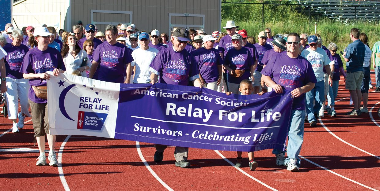 Cancer survivorskick off the 2011 Relay for Life at the high school track in Steamboat Springs Friday night. Participants in this year's event plan to walk around the clock to raise money. It's also a chance to celebrate the lives of people who have battled cancer, remember loved ones lost, and fight back against the disease.