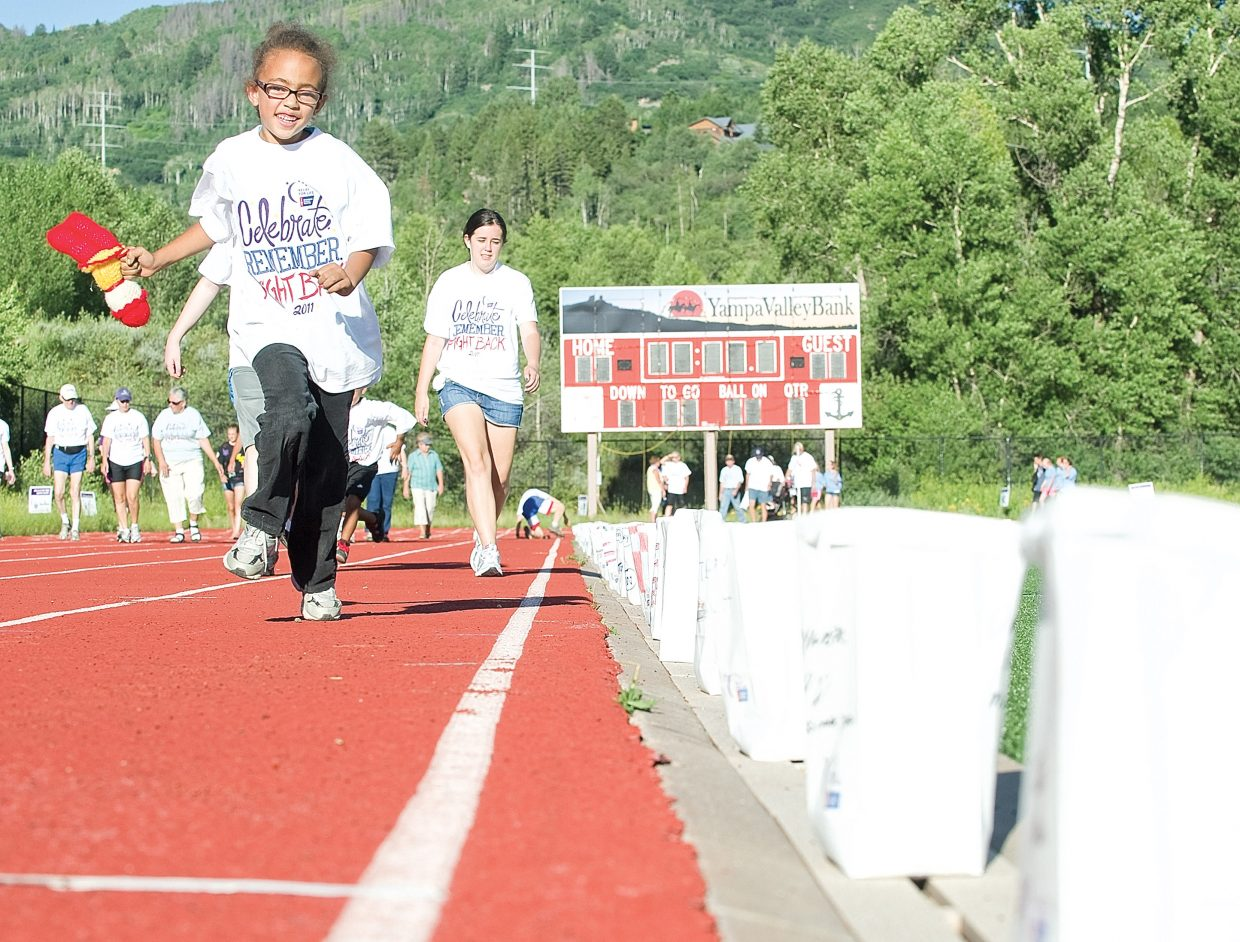 Myla Smith, a great-great-great-granddaughter of Steamboat Springs pioneer James Crawford, runs around the track during the 2011 Relay For Life at Gardner Field in Steamboat Springs on Friday. Smith and other participants in this year's event plan to walk around the clock to raise money.