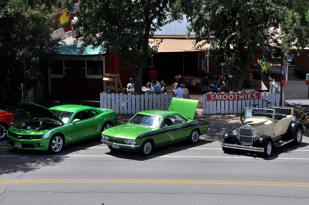 Classic and modern cars line Yampa Street on Sunday during the Motorhead Madness Car Show. A team of volunteer urban planners spent part of the weekend in Steamboat Springs talking with stakeholders about how Yampa Street can be revitalized.