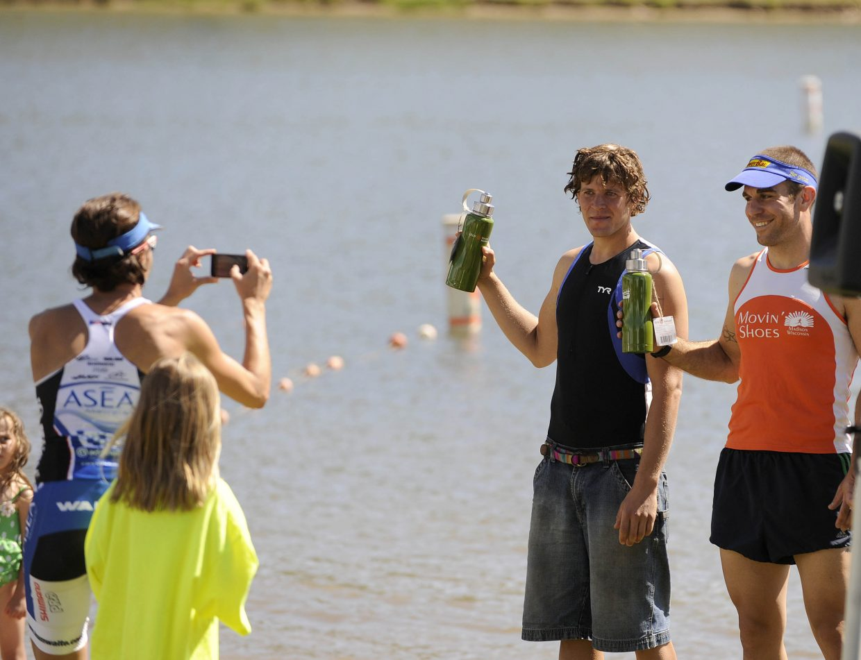 Steamboat's Eddie Rogers accepts his award for winning his division Sunday during the Steamboat Sprint Triathlon. Rogers was the top Steamboat finisher in sixth place.