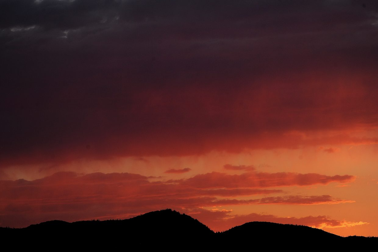 Bright colors fill the horizon as the sun sets over the Yampa Valley Sunday evening.
