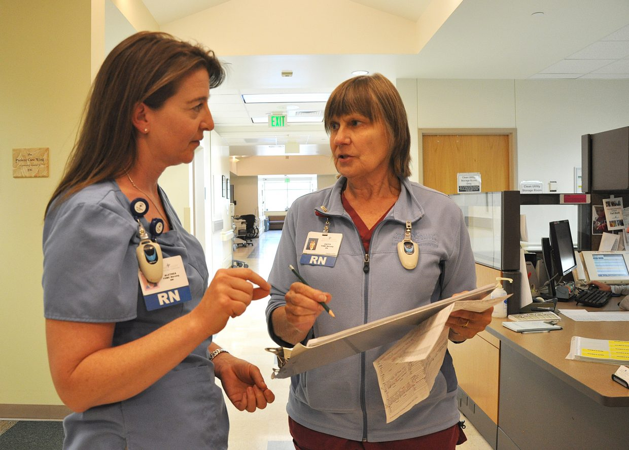 Nurses Alethea Stone, left, and Patty Bender go over scheduling Monday afternoon at Yampa Valley Medical Center's patient care unit. The hospital recently was recognized for patient safety.