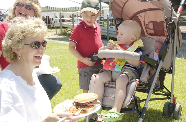 Hayden resident Cydne Bell enjoys her barbeque with 20-month-old Corbin Walden and Ethan Copeland, 4.