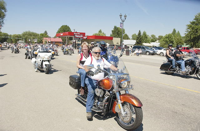 Shriners drive down Jefferson Avenue on their bikes during the Colorado Days parade.