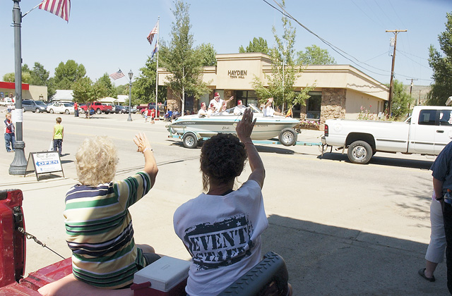 Gloria Smith and her mother, Virginia Erwin, of Craig wave at a boatload of Shriners in the Colorado Days parade.