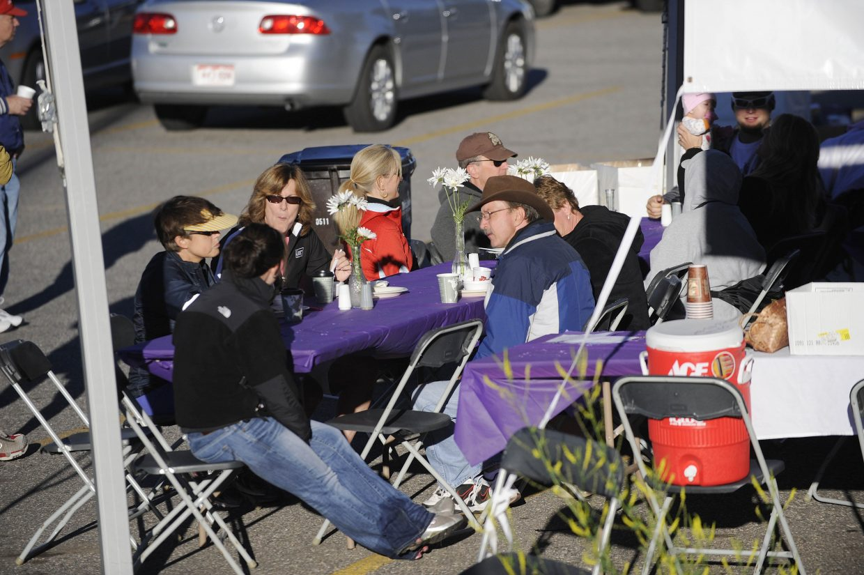 Relay For Life participants have breakfast Saturday morning during the annual event. The event raised $54,000 for cancer research.
