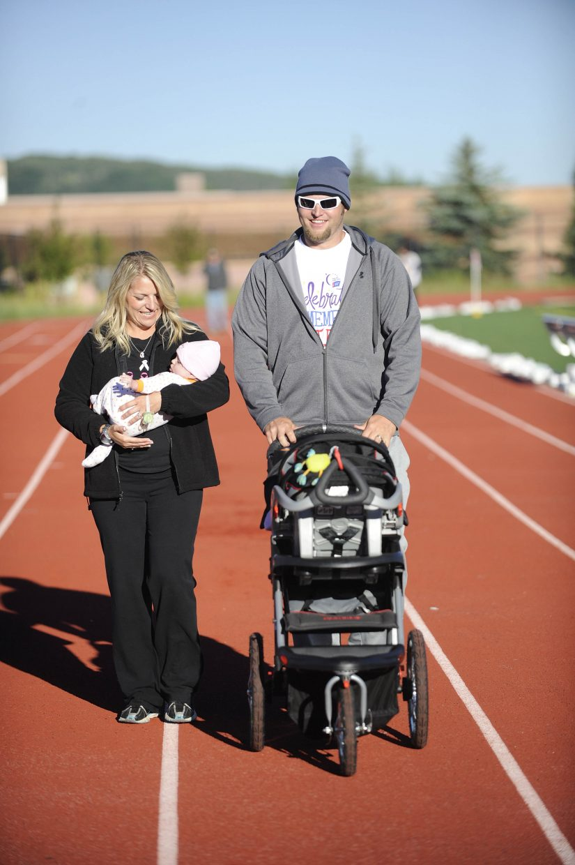 Steamboat Springs residents Sean and Shawndra Winter walk with 4 1/2-month-old Landri at Relay For Life on Saturday morning.