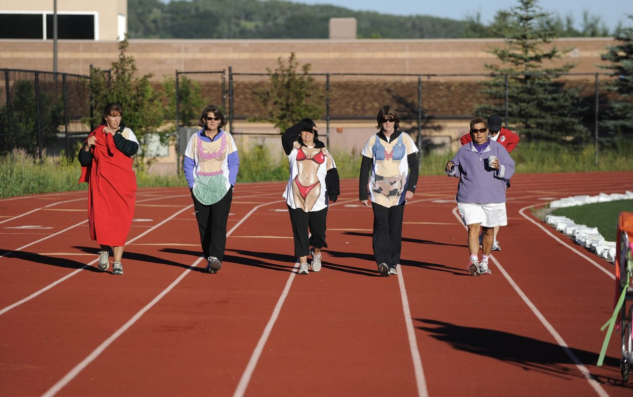 Members of The Road Sisters team walk around the Steamboat Springs track early Saturday morning during the conclusion of Relay For Life.