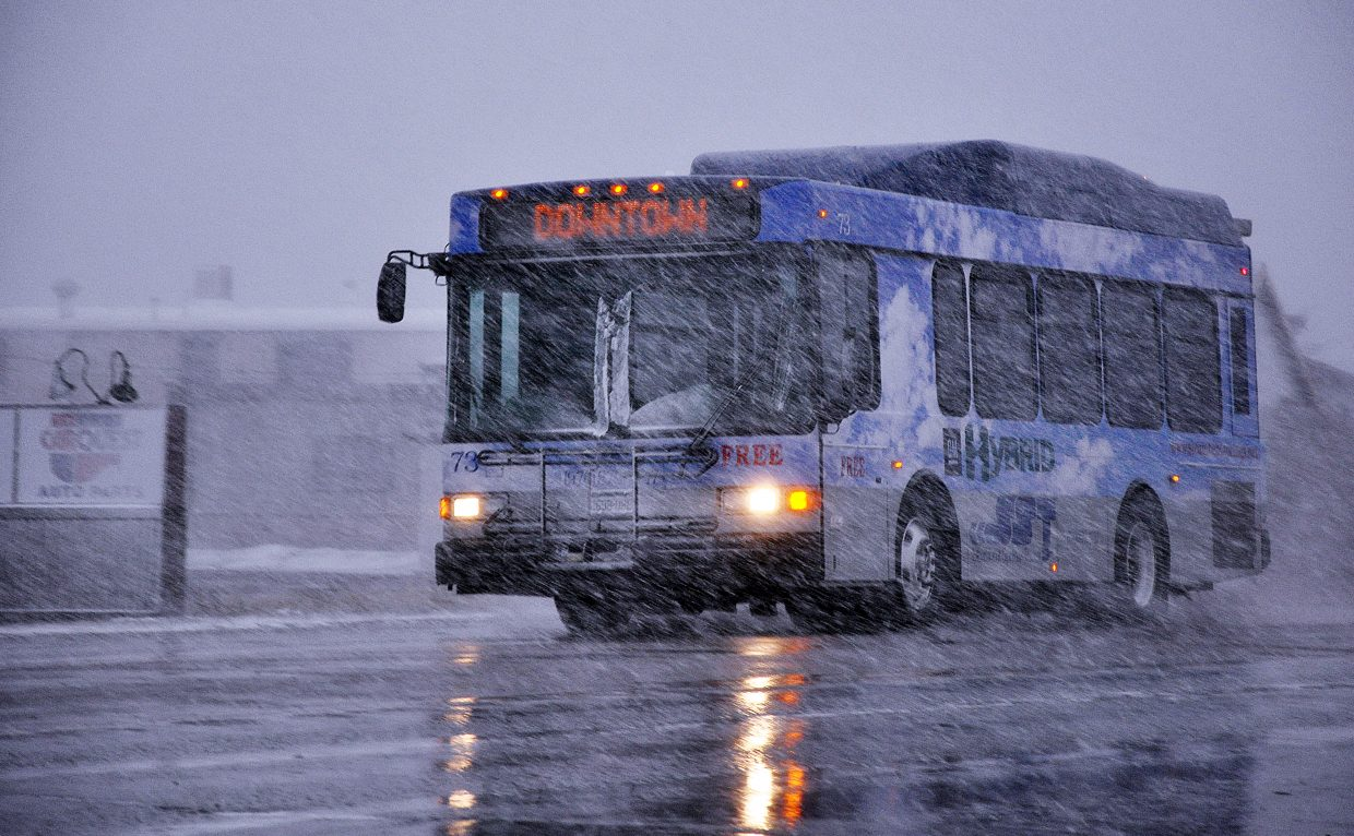 A Steamboat Springs Transit hybrid bus drives through snow on U.S. Highway 40 in the winter. Routt County is one of nine counties in the state that stands to benefit from a new alternative fuel vehicle pilot program.