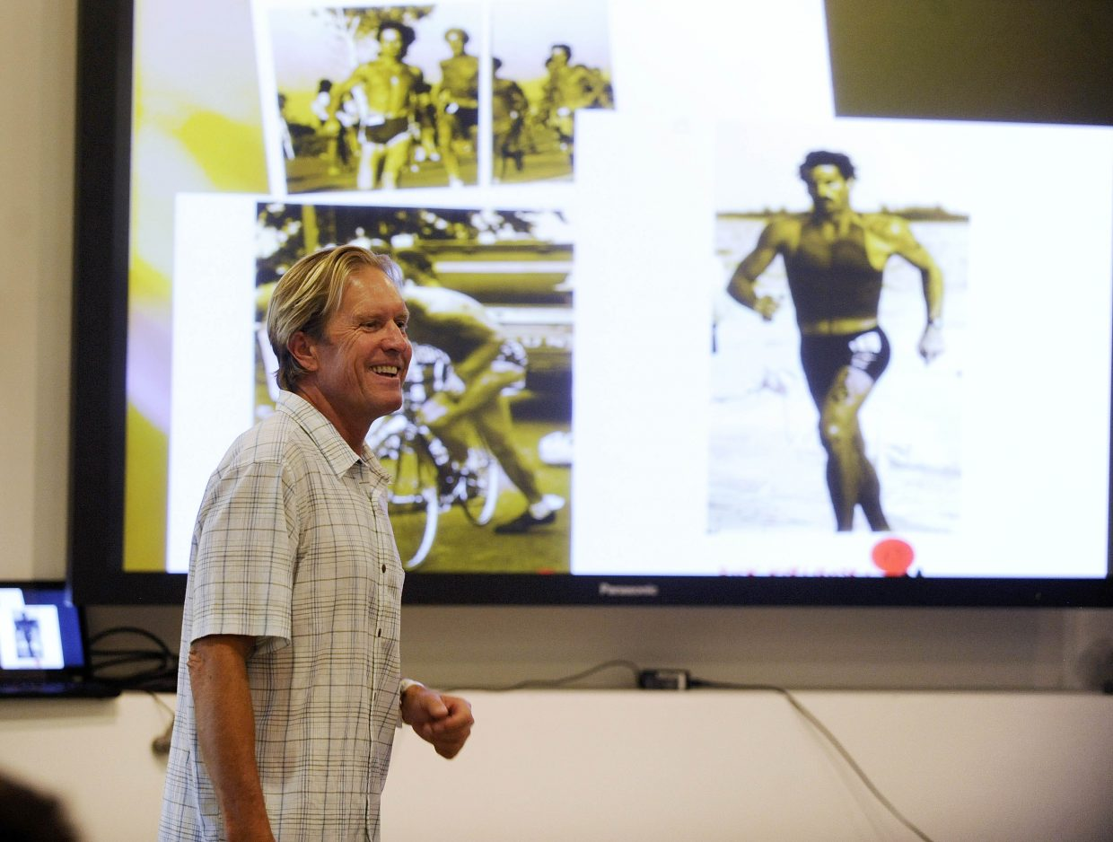 Scott Tinley, two-time Ironman World Championships winner and a member of the Triathlon and Ironman halls of fame, speaks to a crowd of about 30 people Tuesday evening at the SmartWool building. He raced in more than 400 triathlons since 1976 and won nearly 25 percent of them. Tinley talked about the history of the sport and went on a group bike ride with several of the people who attended.