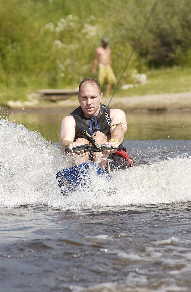 Adaptive water skier John Vcelka takes is pulled down Bald Eagle Lake on Saturday.