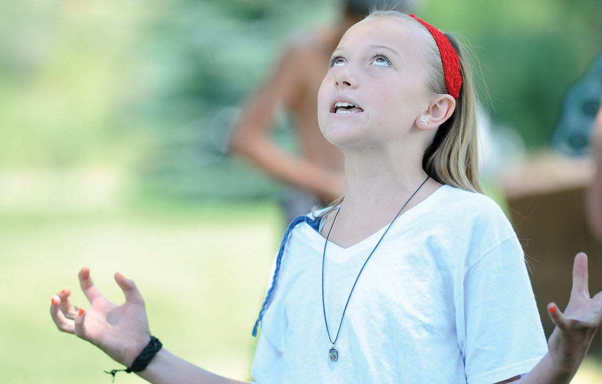 Tasi Harrintgon displays her acting abilities in a skit during the Piknik Theatre Festival children's workshop. The children in the workshop held a performance for family and friends at West Lincoln Park following the completion of the weeklong workshop.