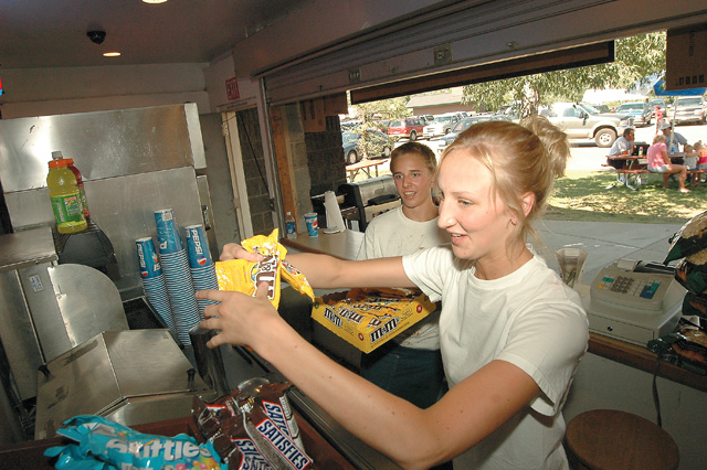 Kelly Larson and Paul Innes restock candy at the Howelsen Hill concession stand Thursday afternoon. Triple Crown and recreational league games have kept business busy throughout the summer.