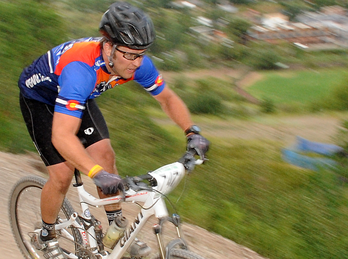 Jeff Snook rides Wednesday on Emerald Mountain in a Town Challenge mountain bike race.