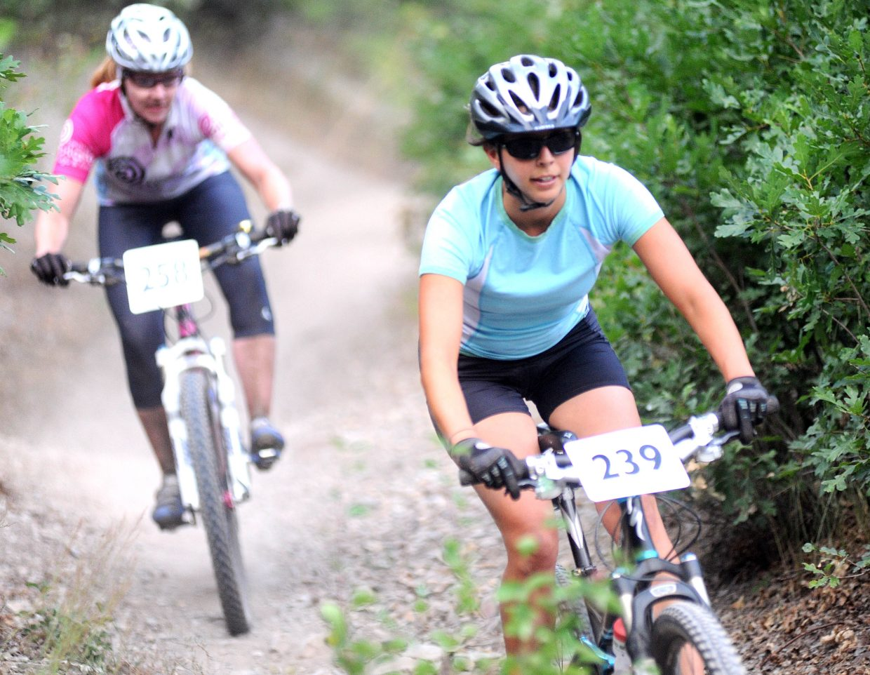 Kyleigh DiMicco, right, and Bec Bale work toward the finish line of Wednesday's Town Challenge race on Emerald Mountain.