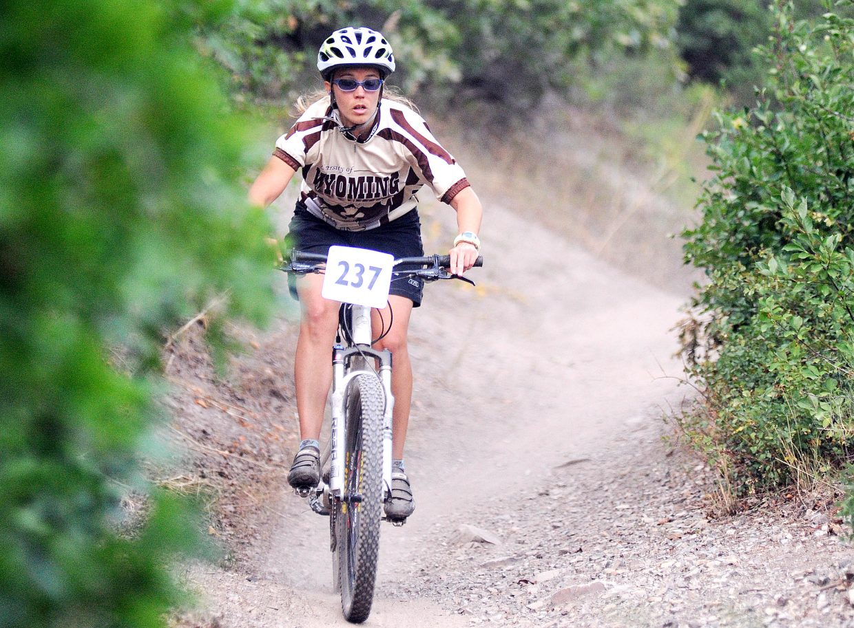 Nicole Lecoyer cruises down the trail Wednesday during a Town Challenge race on Emerald Mountain in Steamboat Springs.