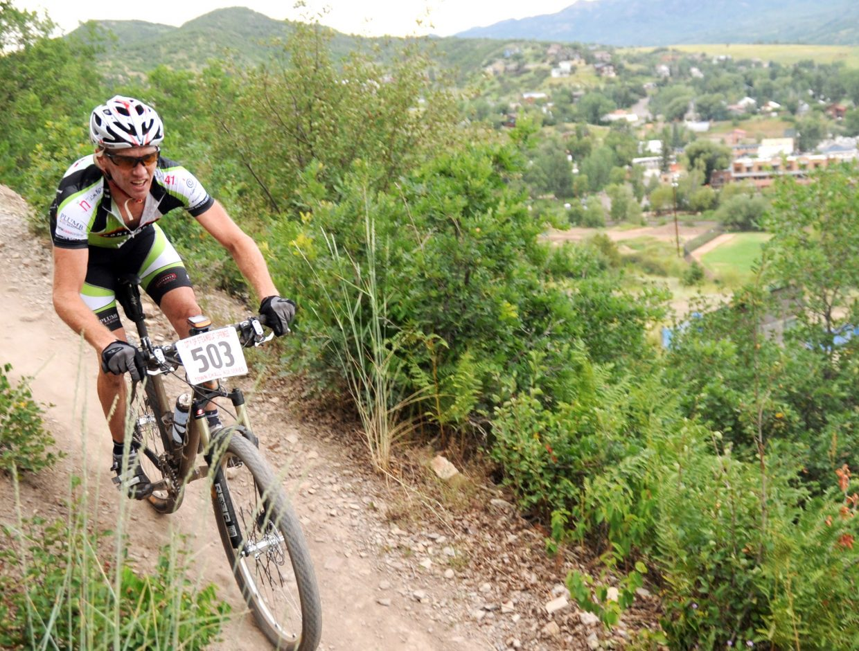 Thomas Meiser rides down Emerald Mountain on Wednesday during a Town Challenge mountain bike race. The race drew 214 registered riders, proving to be one of the most popular in the summer series.