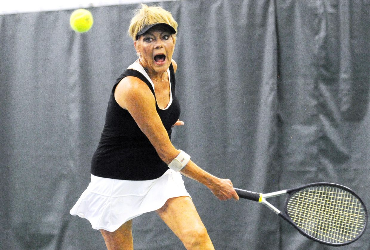 Jan Theadore tracks down a ball for a return Sunday during a doubles match at the annual Steamboat Tennis Association Championships at the Tennis Center in Steamboat Springs. The event was a hit, drawing in more than 140 players for a weekend of action to helped raise funds for the association.