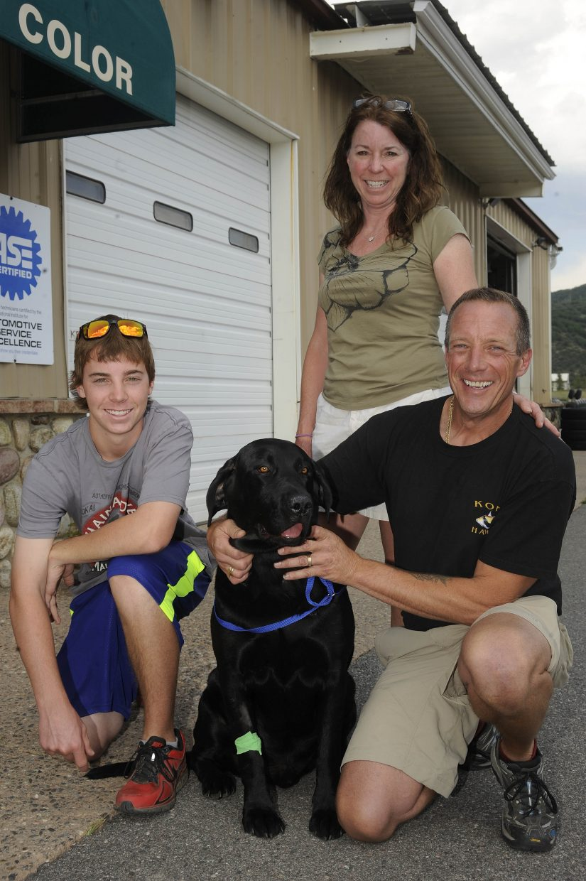 The Mihaich family, from left, Hunter, Patti and Dave, want other dog owners to be aware of the potential danger from rattlesnakes. Their dog Marlie was bitten by one Thursday at their home south of Steamboat Springs.