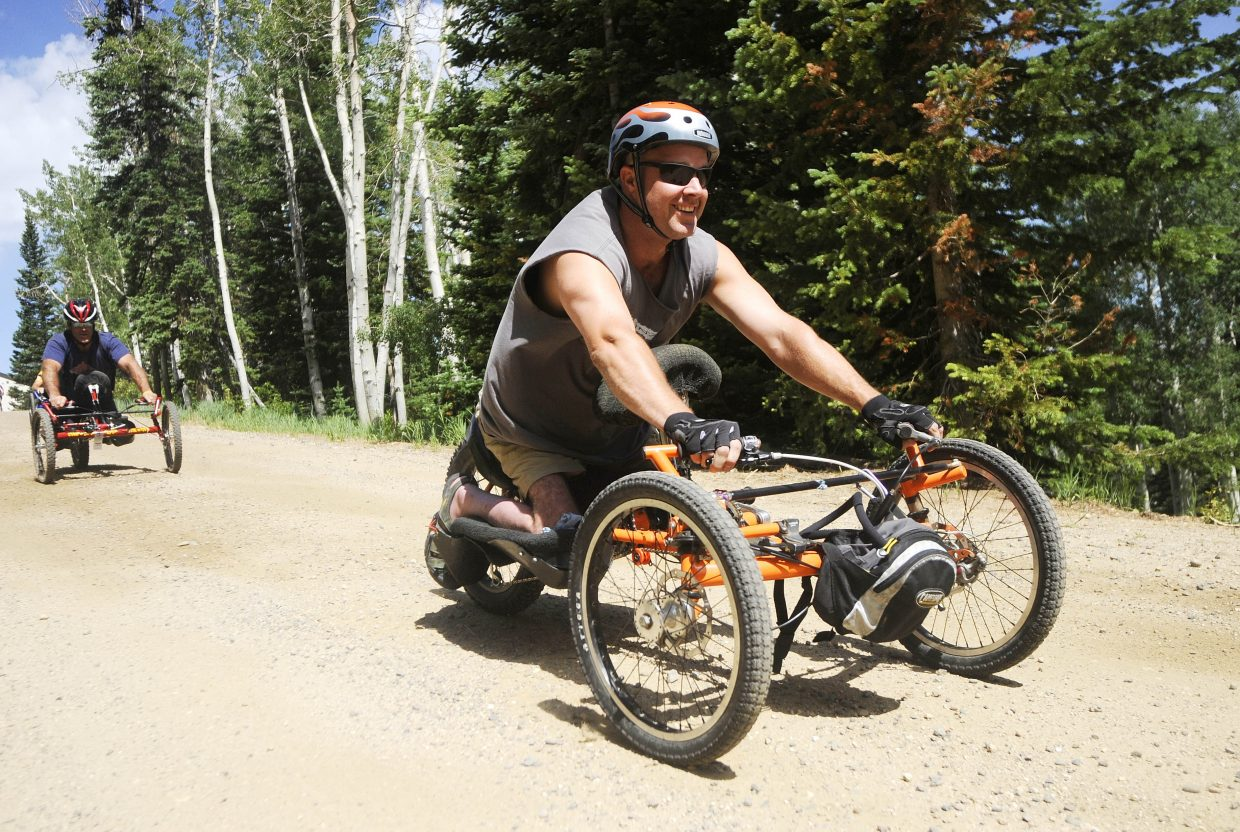 Craig Kennedy rides a hand cycle during an adaptive cycling camp he helped put on in July 2010 at Steamboat Ski Area.