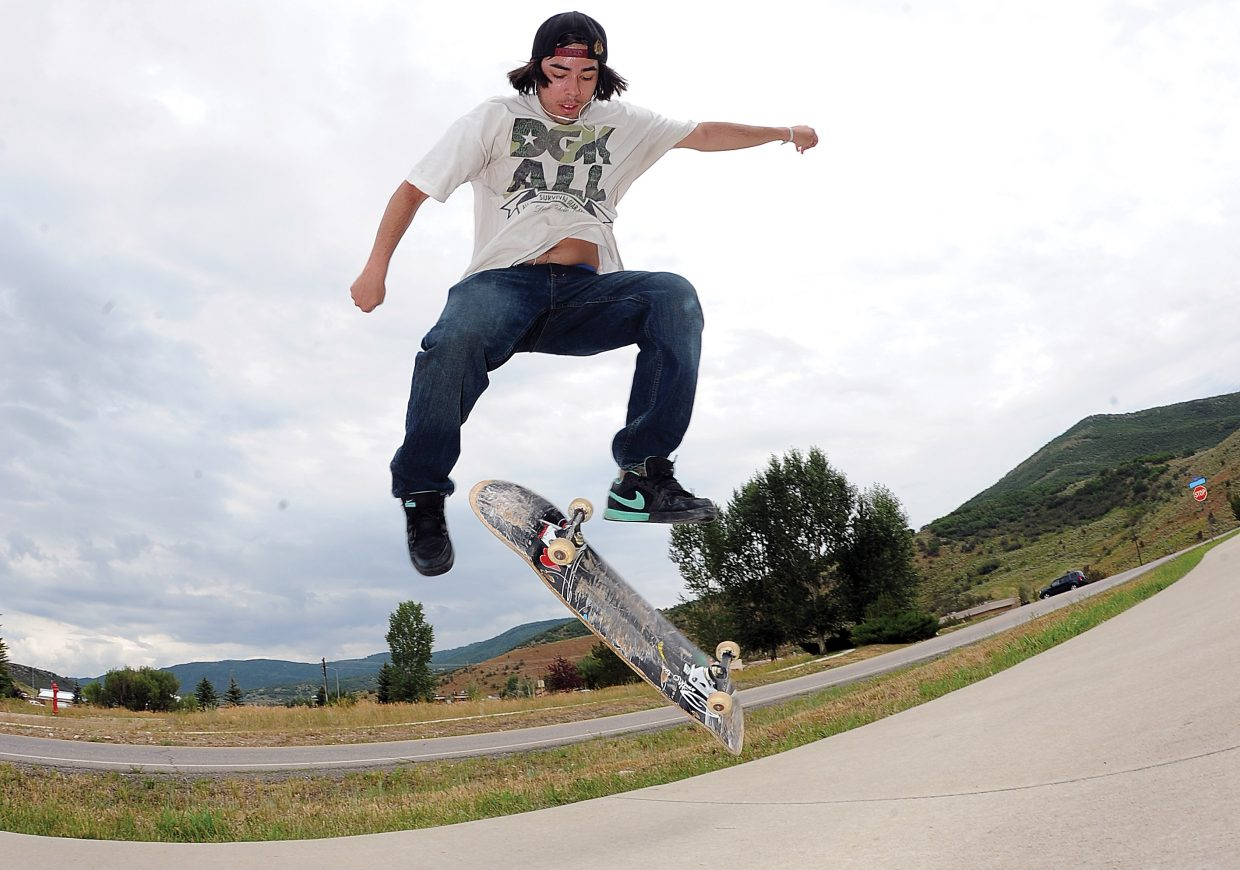 Lester Chabolla works on a few tricks while waiting for his bus in west Steamboat Springs on Monday morning.
