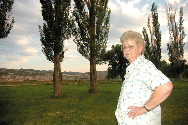Laura Chew stands on a family ranch in Jensen, Utah, where she spends most of her time. The Chew family also owns ranches in Clark and Maybell.