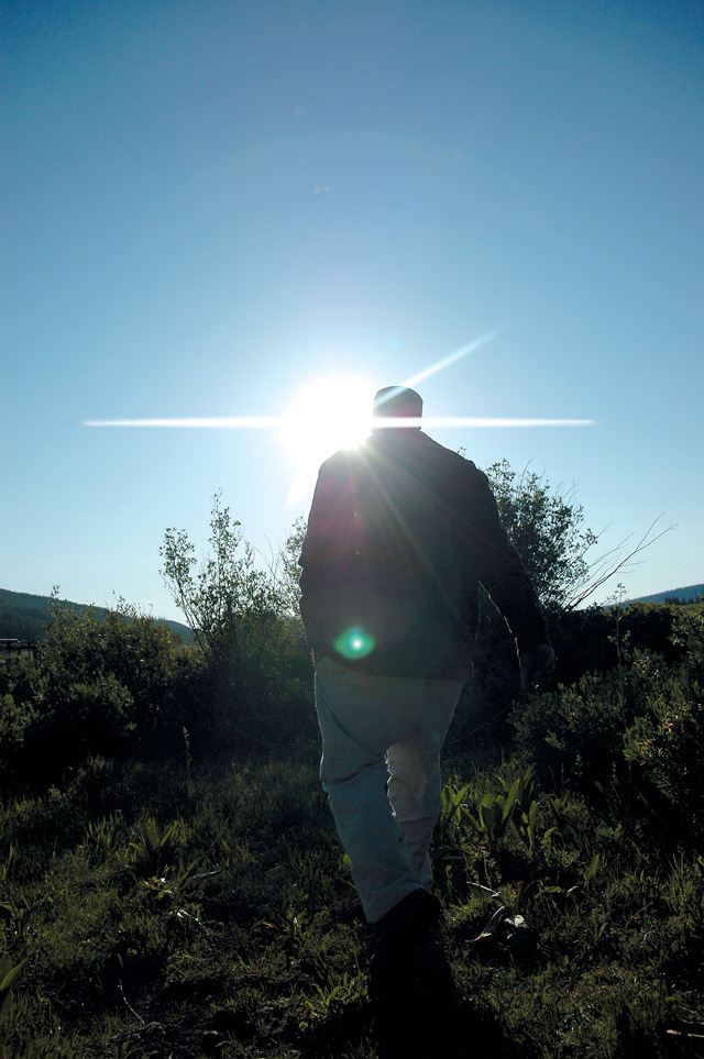 Elvis Iacovetto walks to a large headgate on the Bear River below the Yamcolo Reservoir. The water he releases will be used by more than 100 downstream ranchers.
