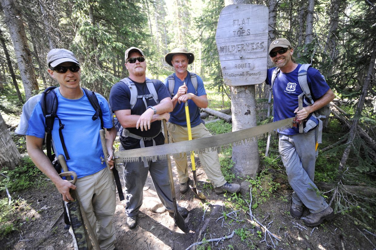 Yampa Ranger District backcountry trail crew members, from right, Justin Benson, Scott Livingston, Bryan Howell and Neal Obray are only allowed to use primitive tools once they enter the Flat Tops Wilderness Area.