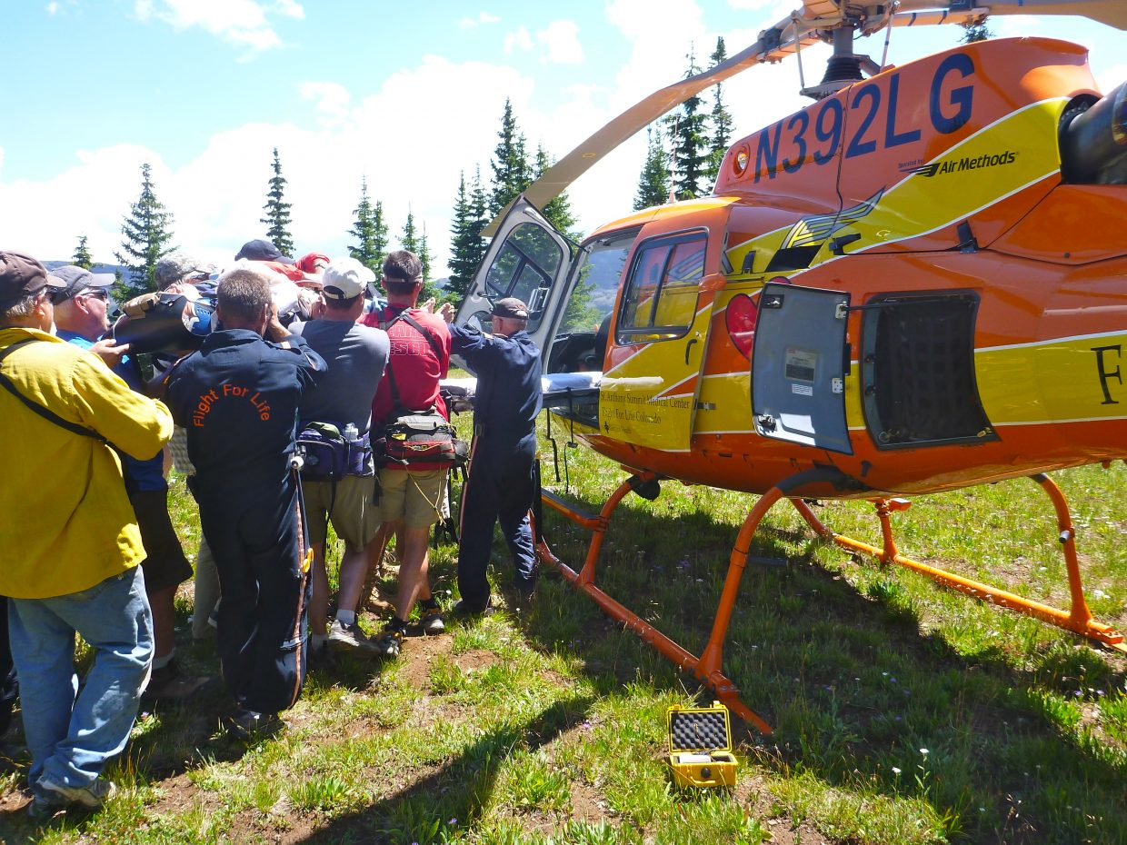 Routt County Search and Rescue crew members and emergency services officials help load a 50-year-old Texas man into Flight for Life helicopter after he fell an estimated 80 feet on the Devil's Causeway trail in the Flat Tops Wilderness Area.