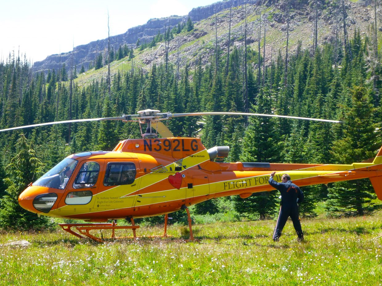 A Flight for Life helicopter prepares to take off from the Flat Tops Wilderness Area on Tuesday to transport a 50-year-old Texas man who fell an estimated 80 feet from the trail that leads to the popular Devil's Causeway crossing.