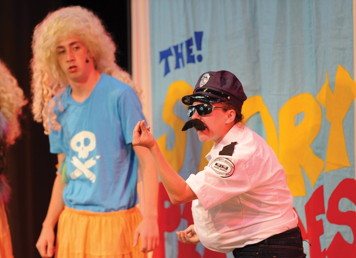 Martha Marion plays the role of a police officer in a skit at the Strings Music Pavilion on Tuesday morning.