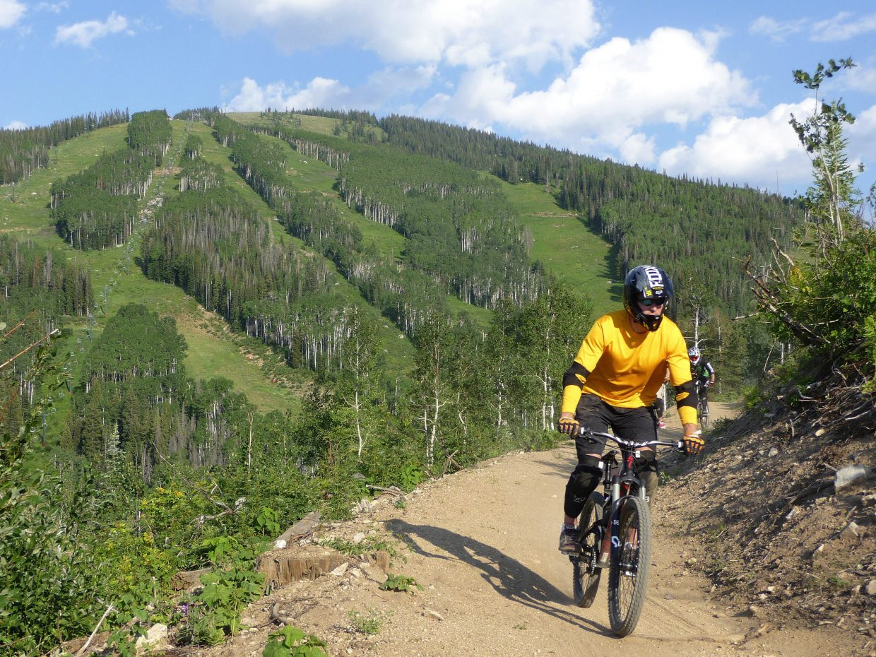Steamboat Springs resident Wade Riniker rides the Tenderfoot trail during a biking clinic Friday at Steamboat Ski Area.