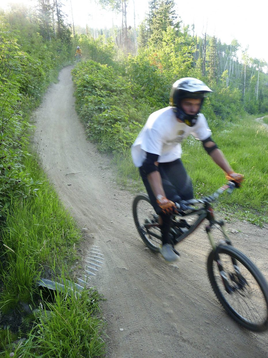 Jake Miller comes down the Tenderfoot trail during a biking clinic Friday at Steamboat Ski Area.
