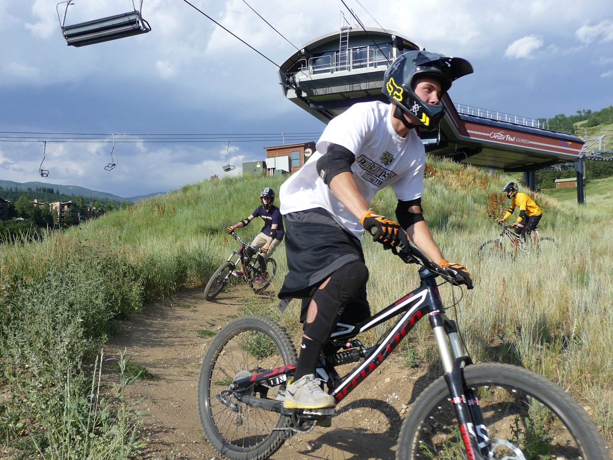 Jake Miller comes down the E-Z Rider trail during a biking clinic Friday at Steamboat Ski Area.