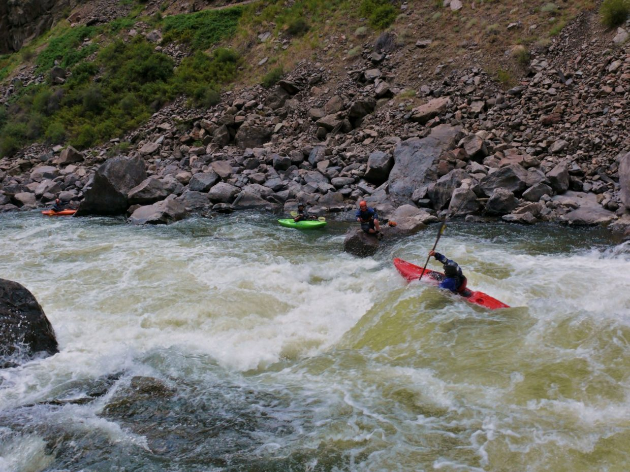 Aaron Koontz boofing Scissors. The group of eleven paddled the four miles of flatwater from Kremmling to enter the Gore Canyon for five miles of whitewater. Submitted by: Matt Helm
