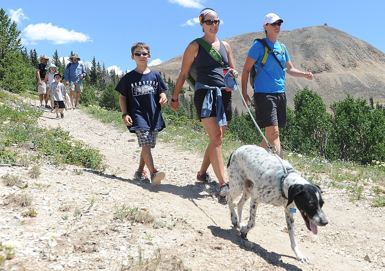 Kim Lavold, from right, Melanie Ranallo and Dominic Ranallo, 8, hike Hahn's Peak with dog Nellie on Saturday. The trail is steep but offers unparalleled views of the region from the summit of the iconic Routt County mountain.