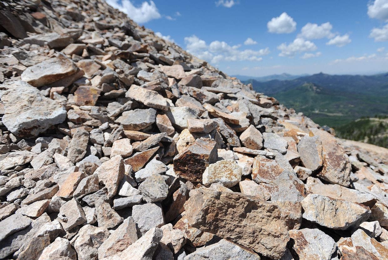 Hahn's Peak is covered by loose rocks. There are some rough trails stomped out, but it's a twisted ankle waiting to happen.