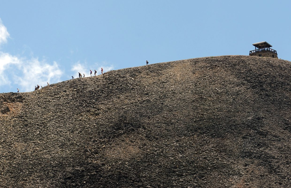 Hikers move away from the summit of Hahn's Peak on Saturday.