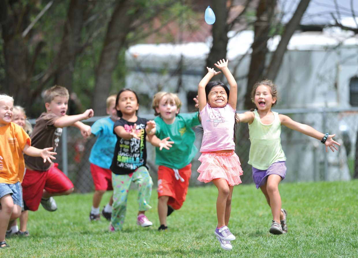 Elena Mather prepares to get soaked by a water balloon during the second annual Camp Olympics at Soda Creek Elementary School on Tuesday afternoon.