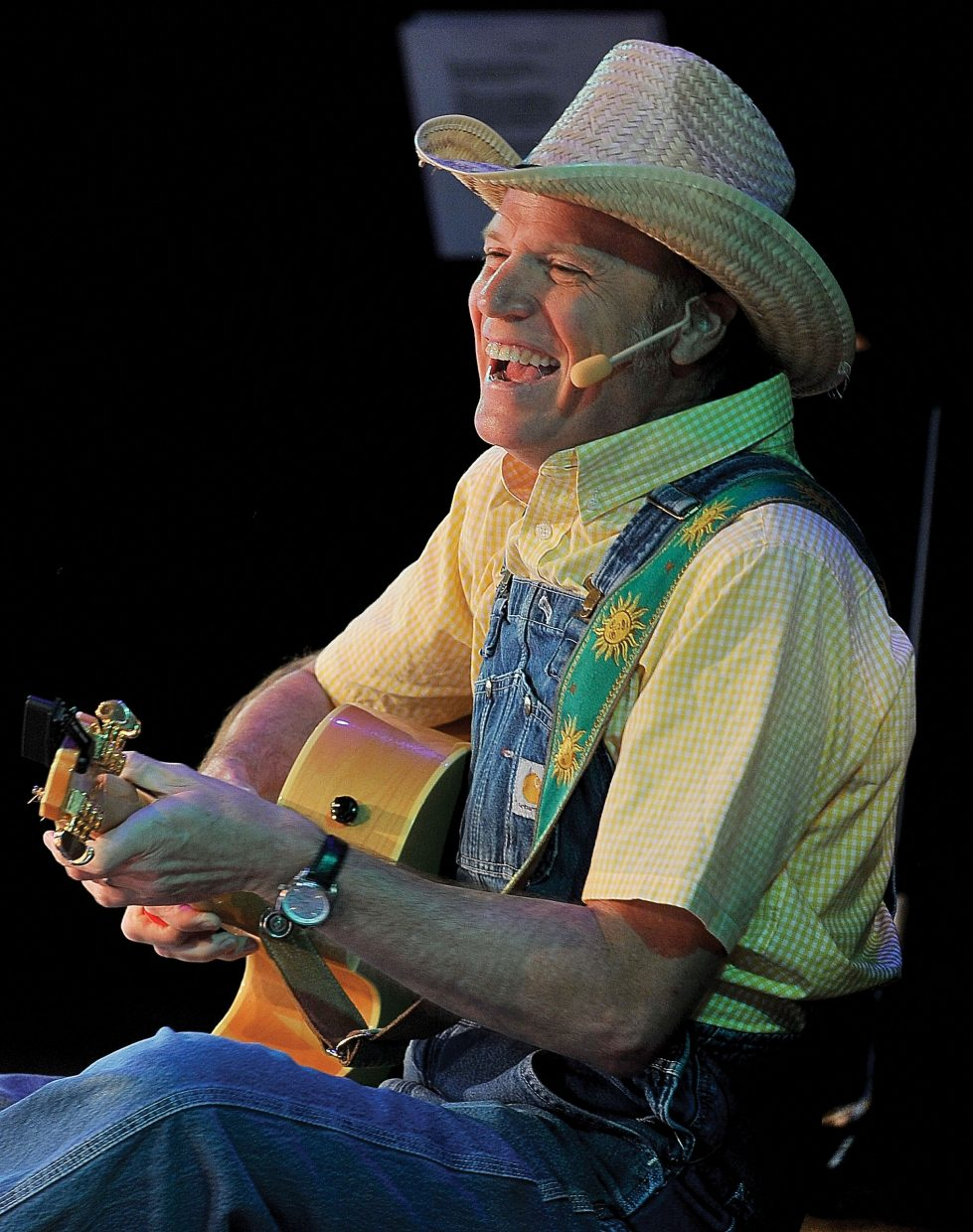 Farmer Jason (Jason Ringenberg) brings his own blend of humor and music to the crowd Tuesday while performing a children's concert at the Strings Music Pavilion.