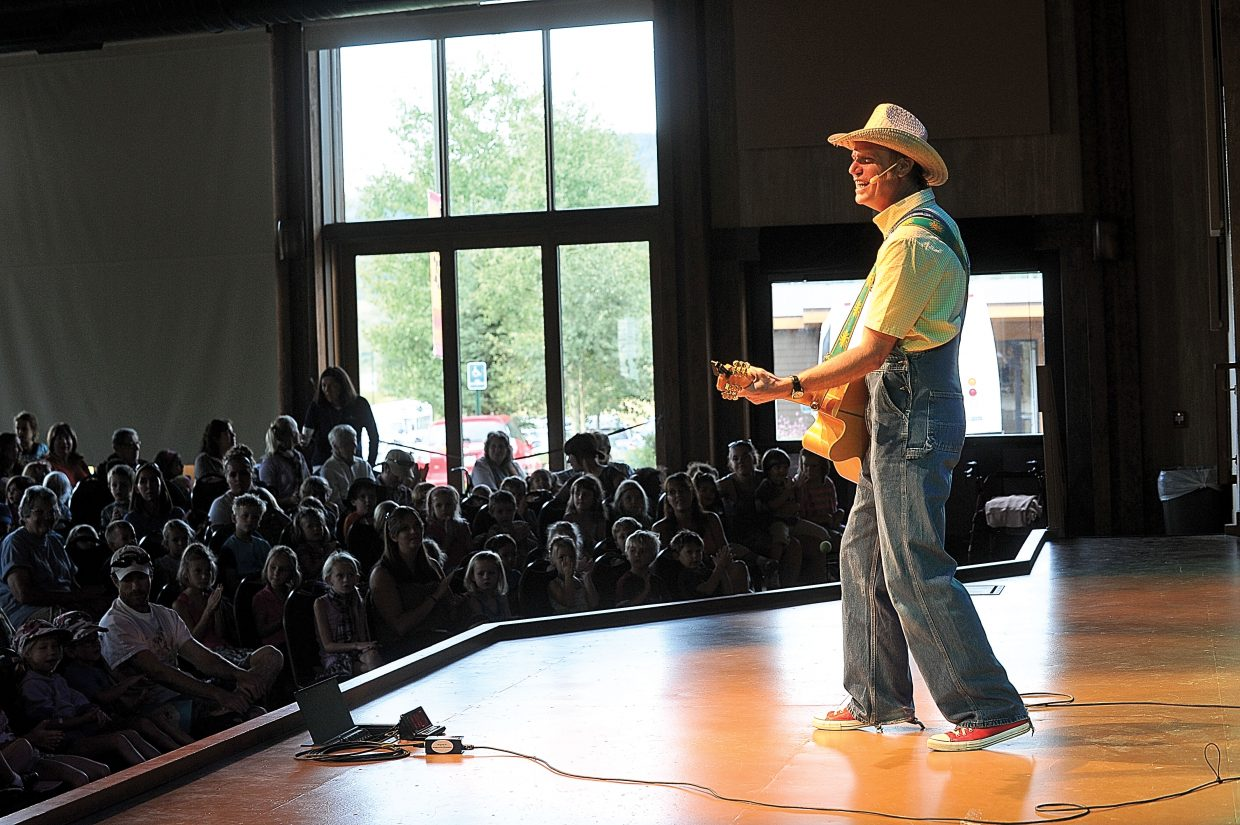 Farmer Jason (Jason Ringenberg) performs a children's concert Tuesday at the Strings Music Pavilion. Farmer Jason delivered his high-energy show to entertain the large crowd.