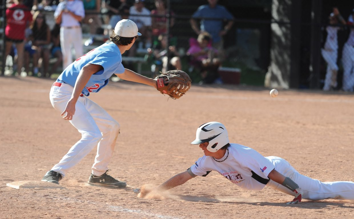 Steamboat Springs baseball player Theo Hansen dives back to first during a Triple Crown baseball game against the Oilers from Texas on Wednesday afternoon. Steamboat, playing in the U13 division, lost the game, 9-3. The team went 2-5 in last week's Triple Crown World Series.